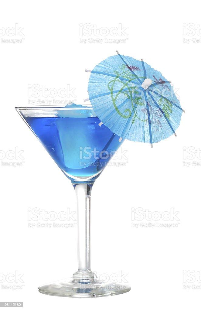 Blue martini mit einem Sonnenschirm Lizenzfreies stock-foto