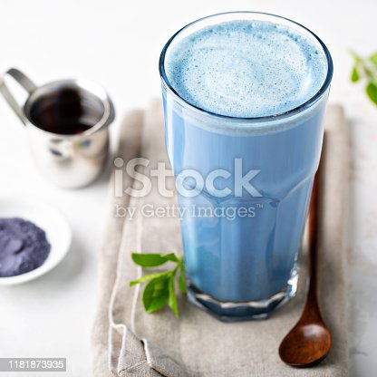 Blue matcha latte in tall glass, tea from the dried flowers of the butterfly pea plant