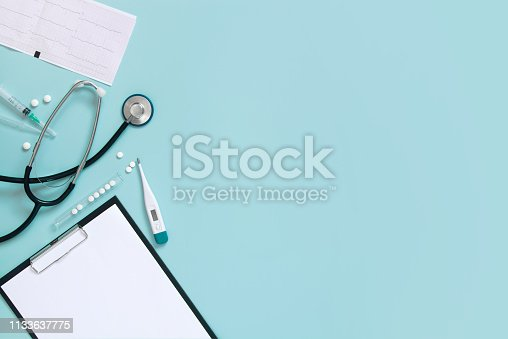 Blue medical background with clipboard and stethoscope, copy space
