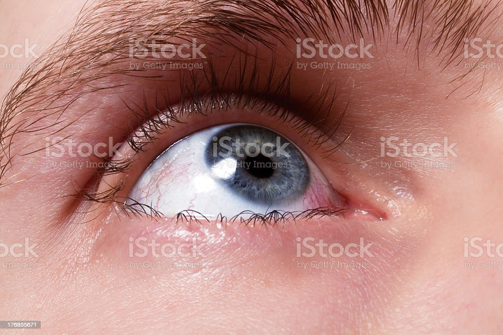 blue men eye with red blood vessels royalty-free stock photo
