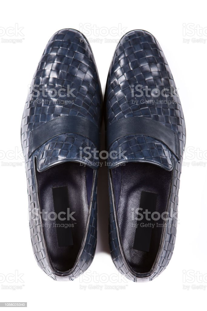 8a6f97980 blue men's shoes made of woven leather, top view, on a white background,