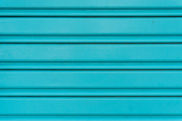 Blue metal sheet steel rolling door for background. Close up view. stock photo