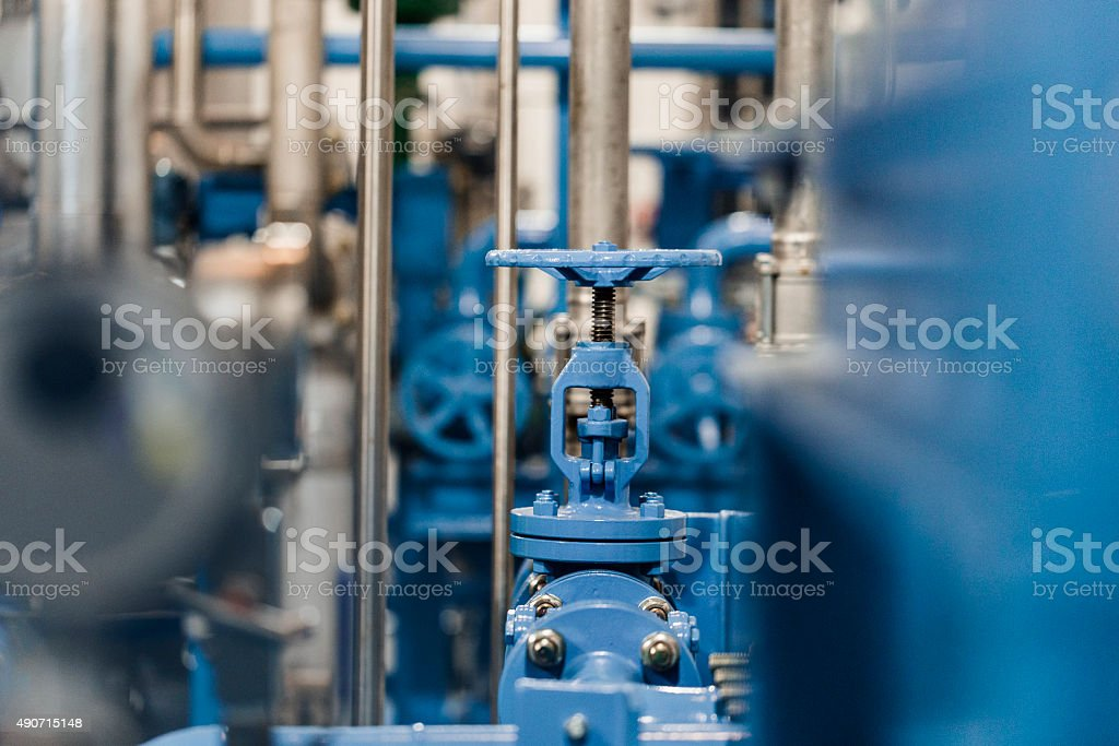 Blue metallic productive tool in industry stock photo