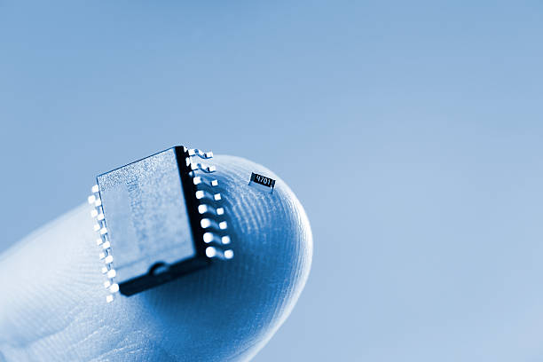 Blue Microchip And SMD  - Technology In Your Hand stock photo