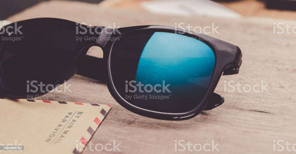 blue mirrored sunglasses on the wooden background close up. horizontal royalty-free stock photo