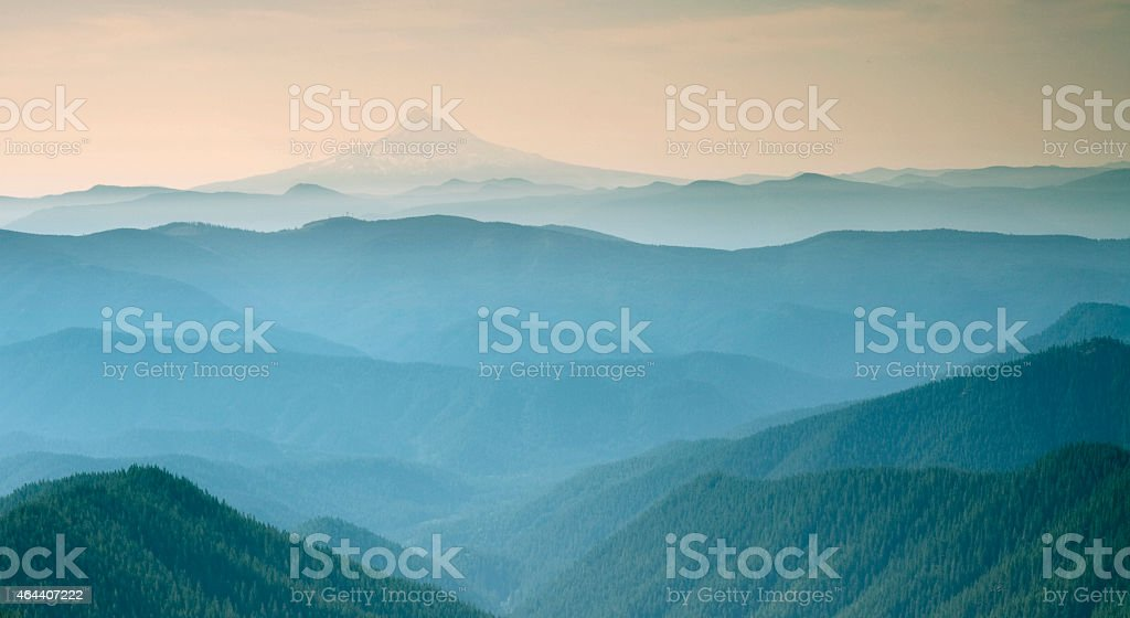 Blue misty view overlooking Mt Adams Washington stock photo