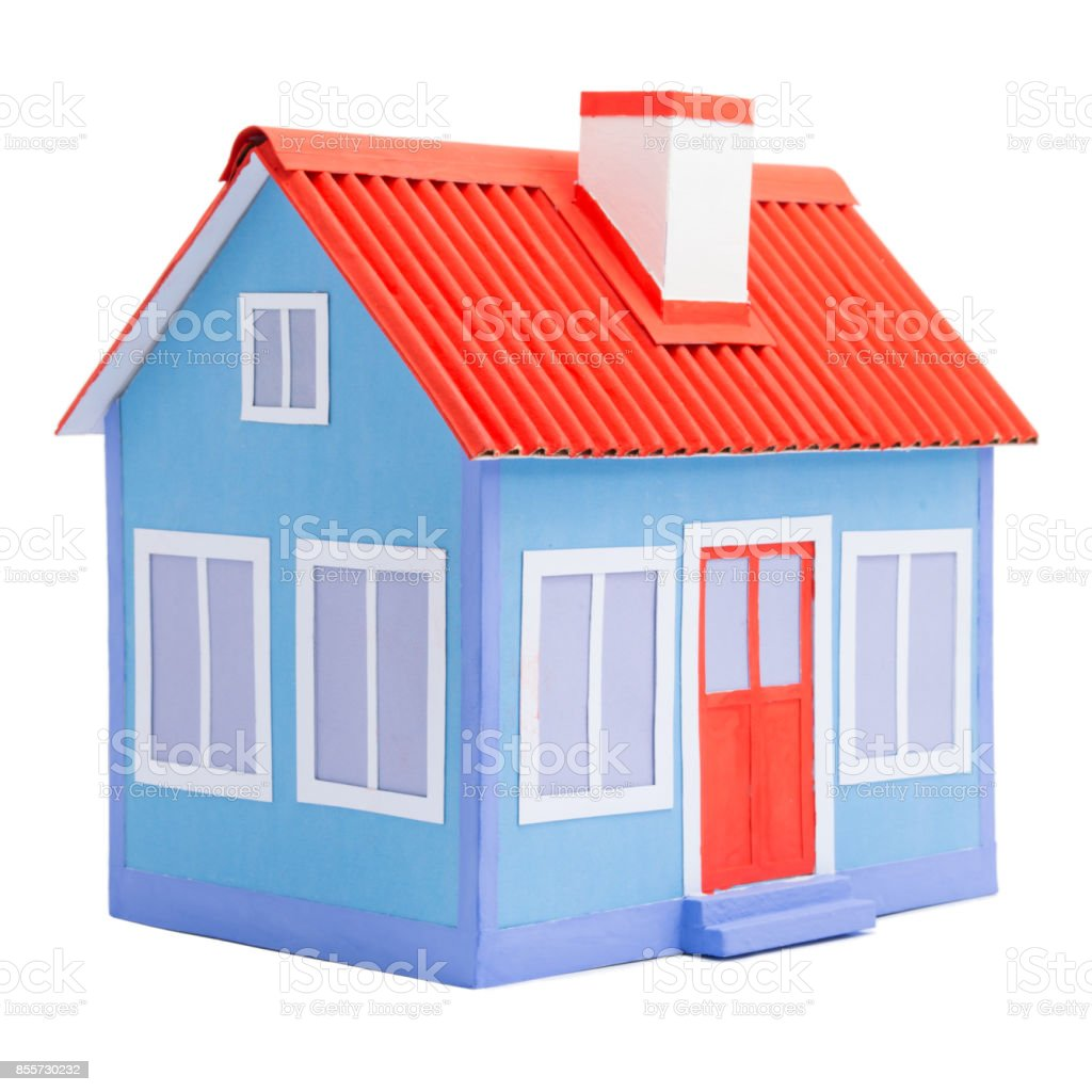 A blue model of house with red roof and door isolated on white background stock photo