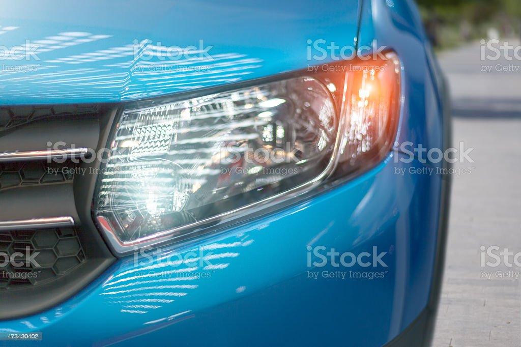 Blue modern car closeup of headlight stock photo