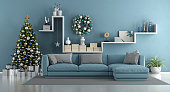 Blue modern living room with christmas tree