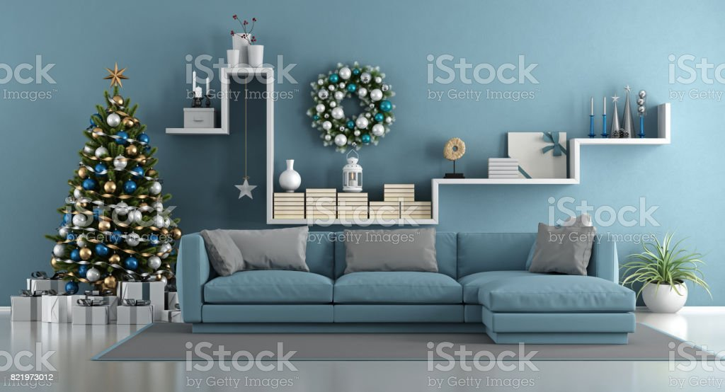 Blue modern living room with christmas tree stock photo
