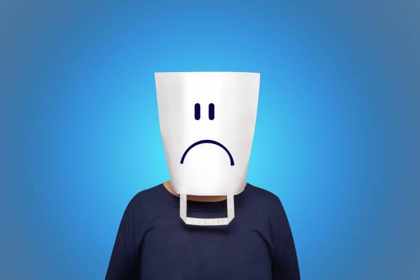 concetto di lunedì blu. tasca bianca sulla testa. - blue monday foto e immagini stock