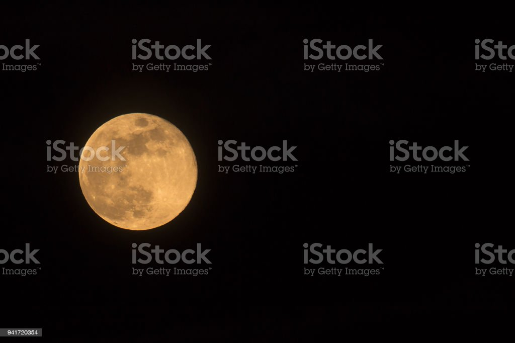 Blue Moon rising on 31 March 2018, landscape orientated image with...