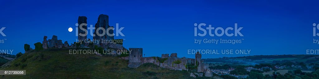 Blue moon rising over Corfe Castle country village Dorset UK stock photo