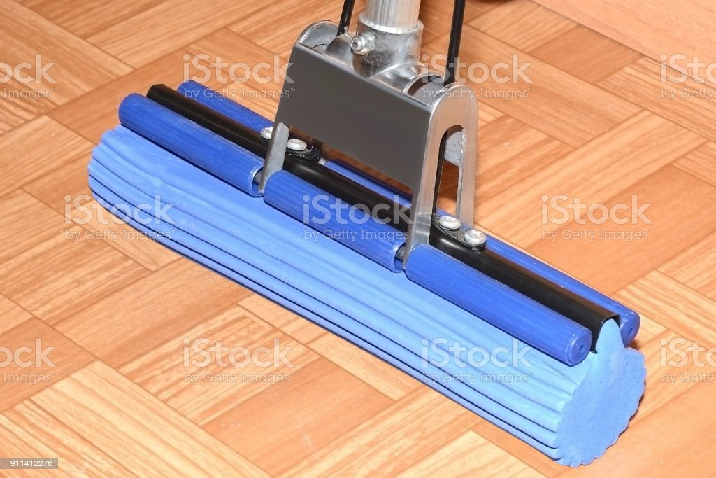 Blue MOP with sponge is on the floor on linoleum stock photo