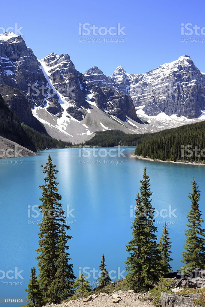 Blue Moraine Lake under the snow-capped Canadian Rockies royalty-free stock photo