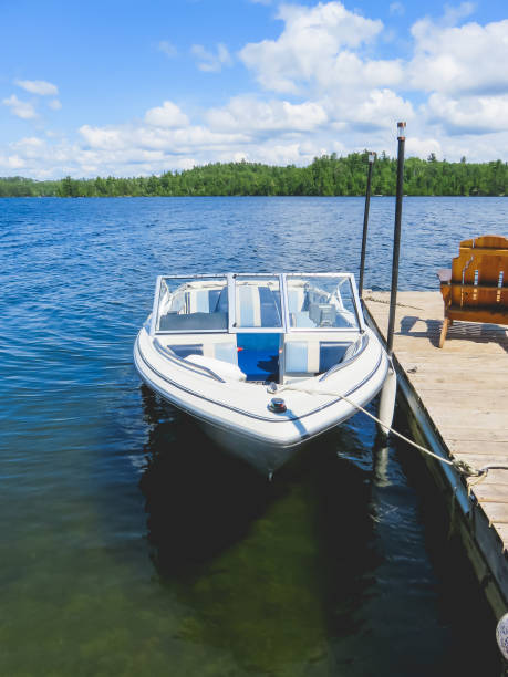 Blue Motorboat tied to the Dock stock photo
