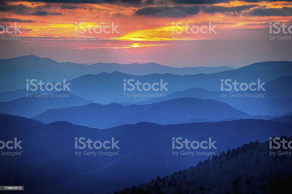 Blue mountain range under sunset stock photo