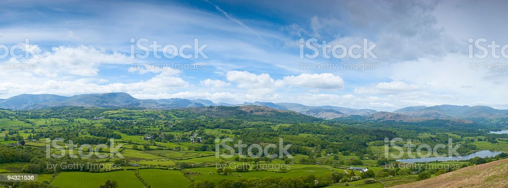 Blue mountains, green fields stock photo