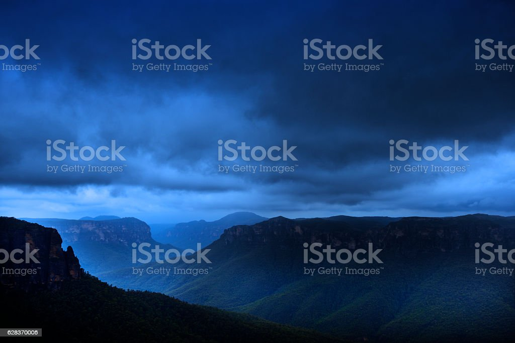 Blue mountains in rain stock photo