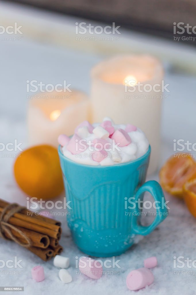 blue mug of drink with whipped cream and marshmallows stock photo