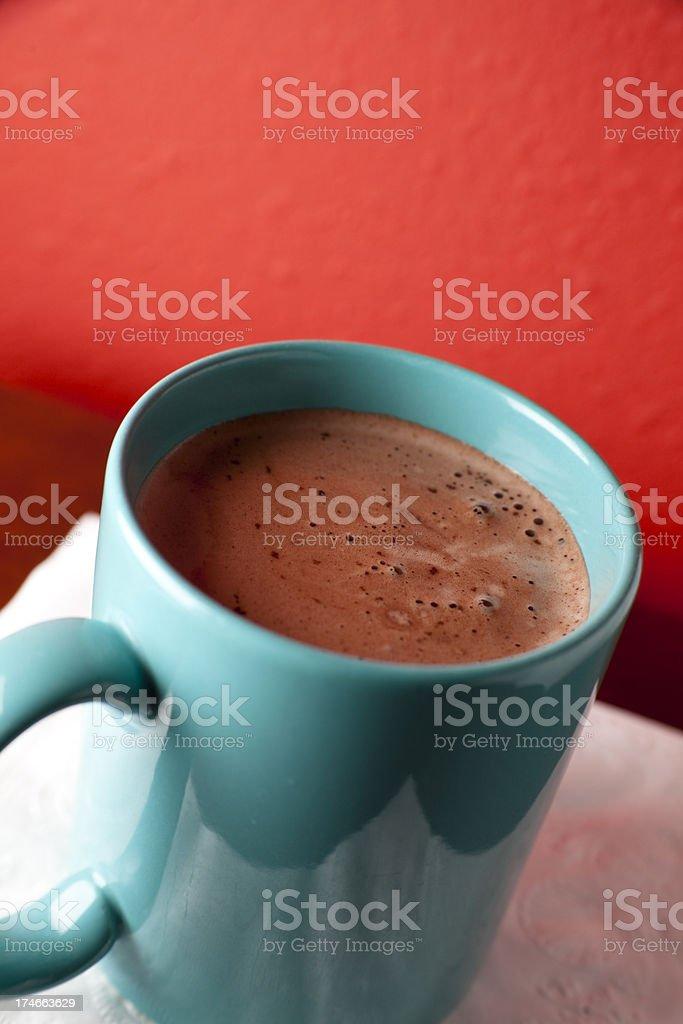 Blue mug of hot chocolate on red background royalty-free stock photo
