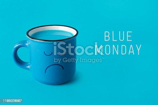 istock blue mug with sad face and text blue monday 1195028567