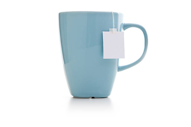 blue mug with tea bag - theekop stockfoto's en -beelden