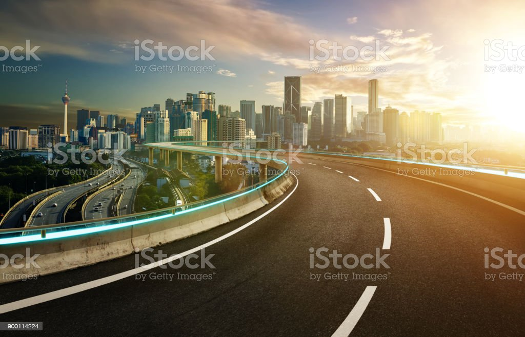 Blue neon light design highway overpass with modern city background .Morning scene . stock photo