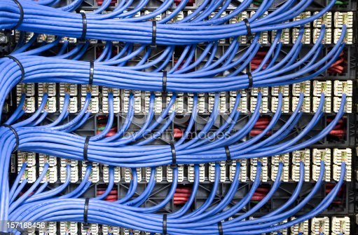Blue network cables neatly channelled into their specified ports.