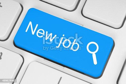 istock Blue new job button on white keyboard 489628962