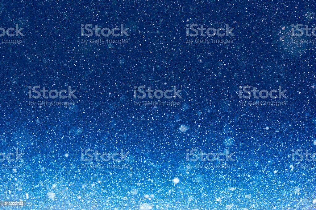 Blue Night Sky Winter Background With Snow Falling stock photo