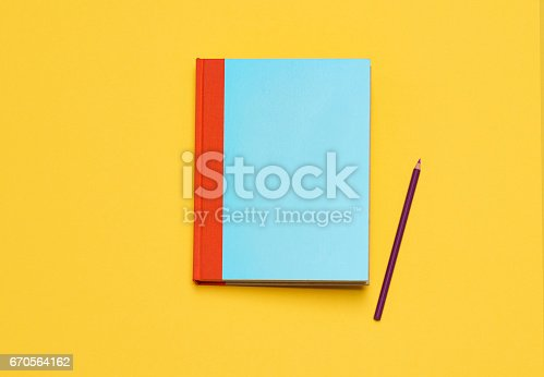 istock Blue Notebook on Yellow 670564162