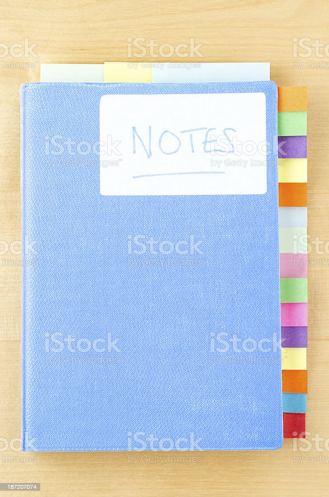 Blue Notebook with Sticky Tabs stock photo