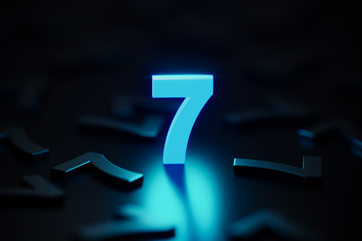 Blue number seven glowing amid black number sevens on black background. Horizontal composition with copy space.