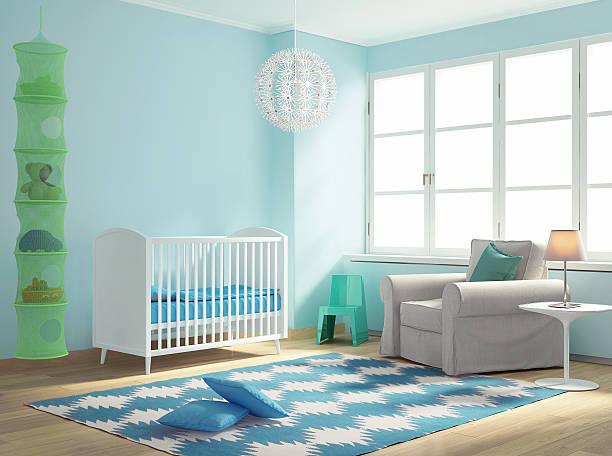 Blue nursery baby room with rug stock photo
