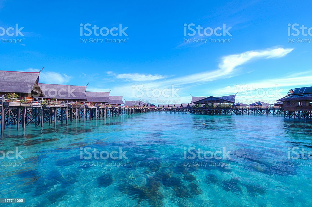 Blue ocean and Water Cottage stock photo