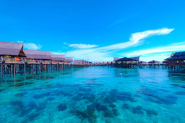 blue ocean and water cottage - fiji stock photos and pictures