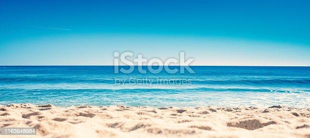 Blue ocean wave on sandy beach. Summer Vacation concept