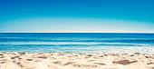 Blue ocean wave on sandy beach. Summer Vacation concept \