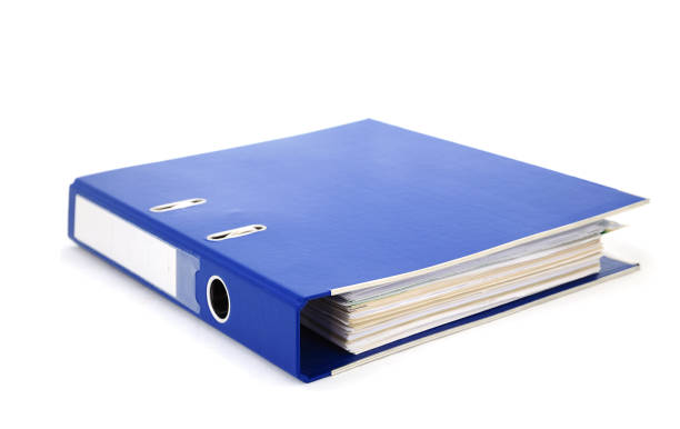 Blue office binder filled with paper on white background stock photo