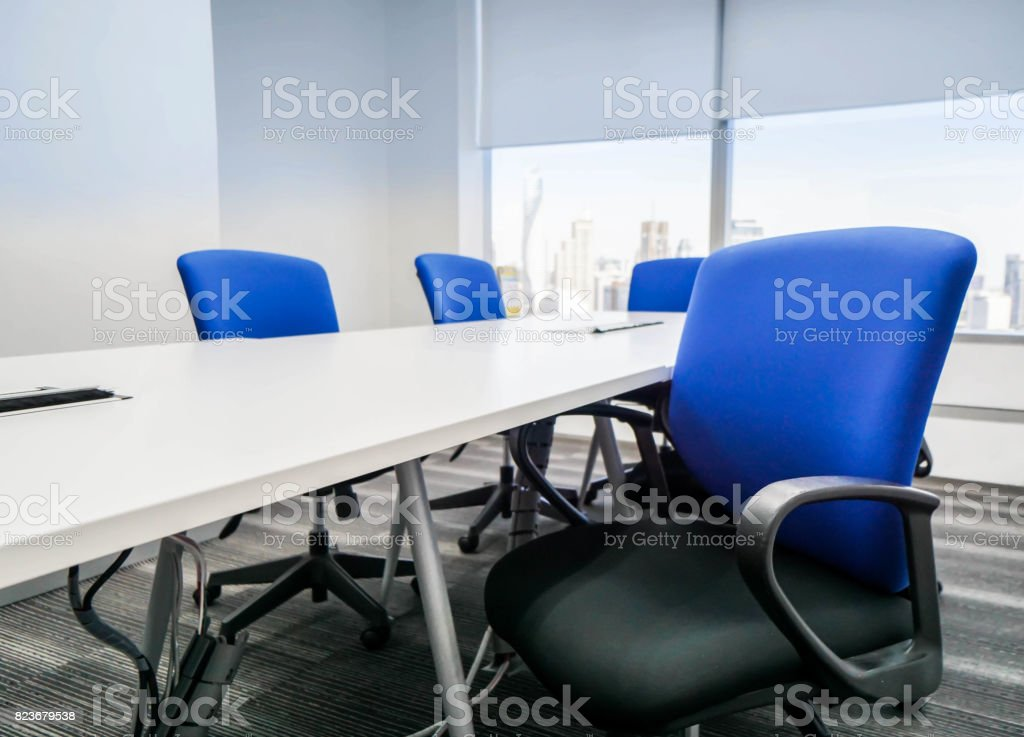blue office chair with backrest in meeting room for seating stock photo