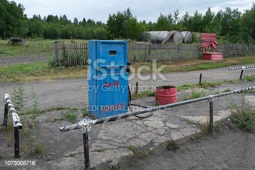 Kamchatka Peninsula, Russian Far East - 30 July, 2018: Blue old Soviet fuel dispenser with mechanical counter scoreboard for gasoline fuel at provincial gas station in Kozyrevsk Village, Ust-Kamchatsky District