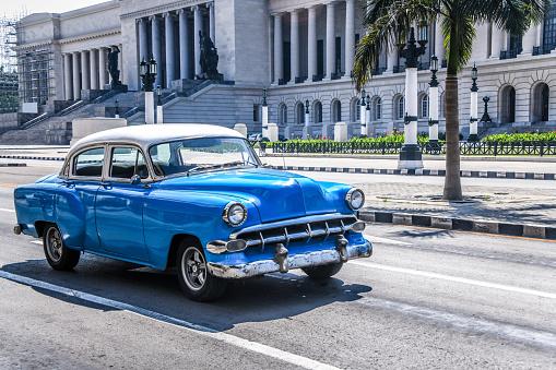 Blue Old Timer Car Near El Capitolio Building In Havana, Cuba