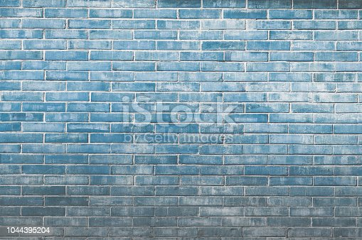 istock Blue old vintage brick wall background,Decorative brick wall surface 1044395204