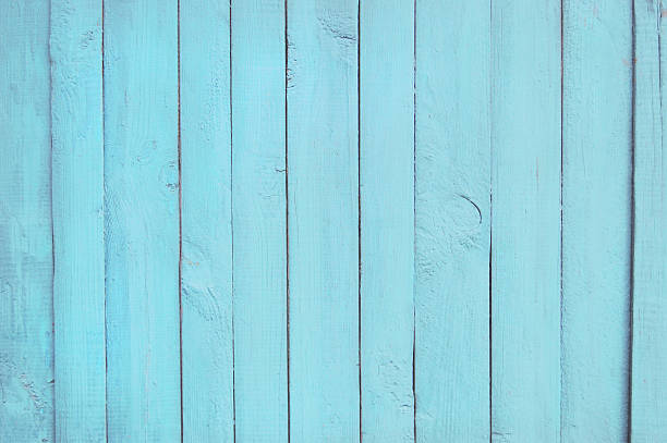 blue old wooden fence. wood palisade background. planks texture - palisade boundary stock photos and pictures