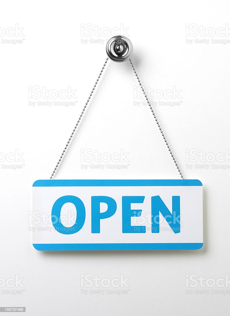 blue open door sign on a silver chain stock photo