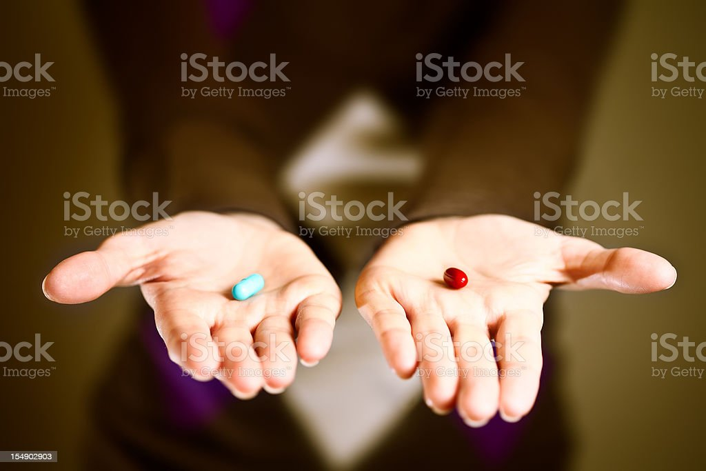 Blue or red pill - your choice stock photo