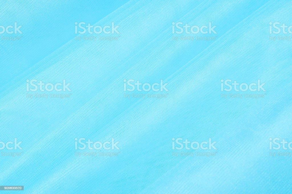 blue organza fabric wavy texture stock photo