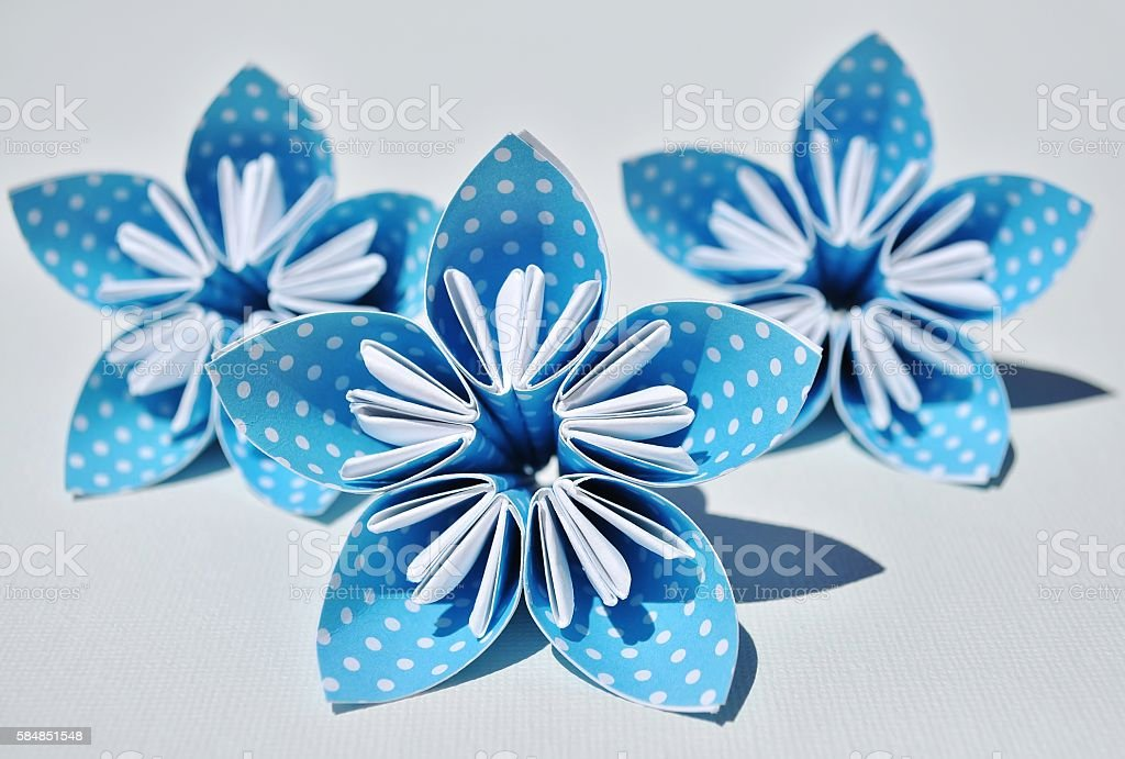 Blue origami flowers. stock photo