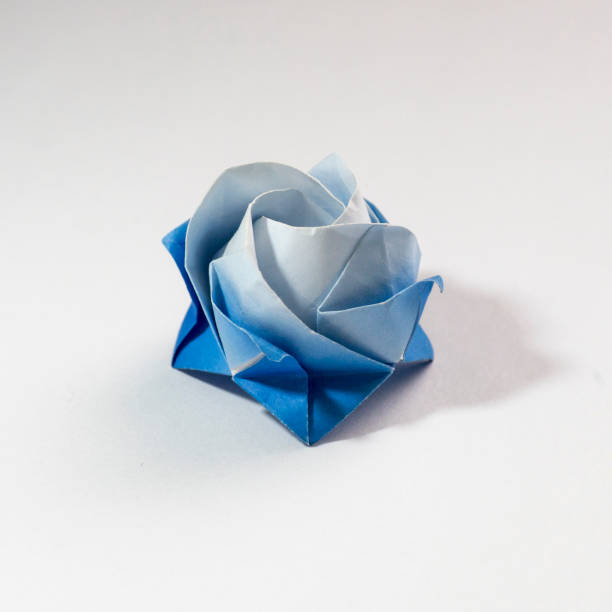 Blue origami rose head stock photo